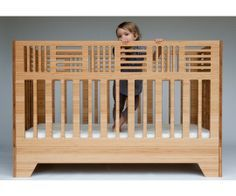 Ioline Crib from Kalon Studios. Named one of the top 100 green products in the world by Time Magazine the crib comes in two styles: Classic and Io. Open on all four sides the crib provides 100% visibility from inside and out. When it's time, the crib easily transitions into a modern, low-lying toddler bed, extending the life of this piece to 6+ years. No additional kit is required.