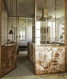 Méchant Design: rustic kitchen with glass window walls, fantastic....