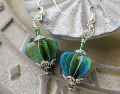 These beautiful earrings are made with artisan paper beads made from handmade paper