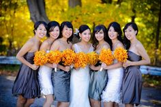 Golden bouquets and gray bridesmaid dresses make for a rustic wedding reception. #Autumn Wedding #fall wedding