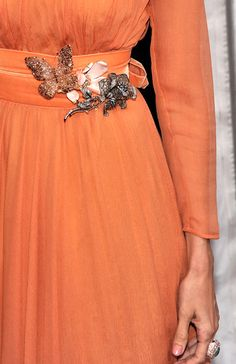 Eva Mendes wearing gorgeous Lorraine Schwartz brooches