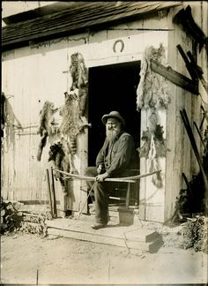 Appalachian Hunter...notice the horse shoe above the door. An old Appalachian tradition for good luck. My great-grandparents did this.