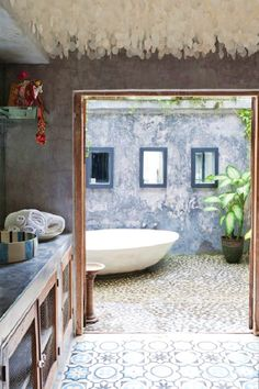 Outdoor Bath- sliding door replaces window in downstairs bathroom so that bath becomes outdoor