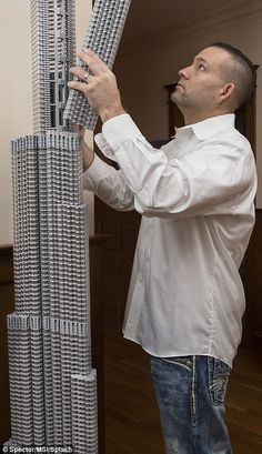 The Lego wonders of the world! Former architect finds his 'life's work' in building the world's most famous structures with plastic bricks Adam Reed Tucker, 44, is one of only 14 Lego Certified professionals in the world Tucker is pictured building Dubai's Burj Khalifa