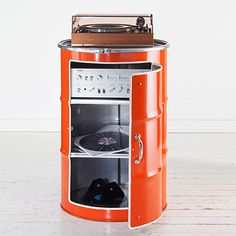 recycled oil barrels turned into media storage centre - We have seen oil barrels turned into barbeques and braais, but this new take on reclaimed style is definitely one I would love in my home, and one that you could do yourself with some power tools and a few materials and supplies.  - See more at: http://www.home-dzine.co.za/crafts/craft-drum-cabinet.htm#sthash.W2Npydmj.dpuf