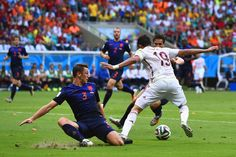 Stefan de Vrij of the Netherlands moves in to challenge Diego Costa of Spain in the first half during the 2014 FIFA World Cup Brazil Group B match between Spain and Netherlands at Arena Fonte Nova on June 13, 2014 in Salvador, Brazil.