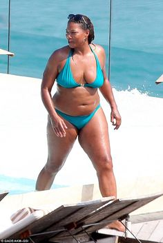Queen Latifah wearing a bikini that is not a fatkini and looking fabulous. I love fatkinis but you don't have to wear one if you are a large/fat woman as Her Majesty shows.