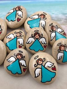 These pocket pebble angels make great little gifts and tokens of appreciation! This is a set of 10 that comes in a little muslin drawstring bag. They make great Sunday School gifts and tokens for hospital patients. Click to see more images. #pocketangels #pocketangeltokens #pocketrocks #guardianangels #guardianangeltokens #angelpocketrocks