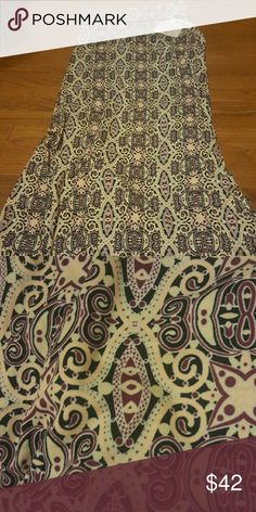 Lula Roe Maxi-Small Beautiful size small Lula Roethlisberger Maxie with a  purple, black, mint, and blush print. This print is perfect for back to school attire! Wish it fit me!!! LuLaRoe Skirts Maxi