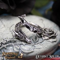 Alchemy Gothic AG-R183 Vis Viva Ring  A pewter wrap-around dragon-serpent ring, set with three black Swarovski crystals.