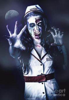 Female medical zombie biting at the lip in chilling bloodthirsty style standing at a night cemetery in the cool mist and moonlight. Dawn of the dead by Ryan Jorgensen