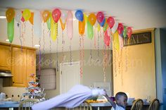 Great idea for non helium ballons, stick them to packing tape! Thanks Allison Kimball