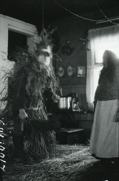 "Nordic Thoughts: The Yule Goat "" A Nuuttipukki in straw outfit and sword, in the town of Myllylä, Itis, Finland, 1926.  Photo: Aino Oksanen, Museiverket"""