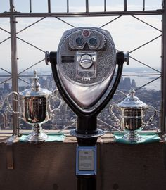 August 6, 2013: Before the 2013 games begin in late August, the @US Open Tennis Championships trophy pays a visit to the Empire State Building! Which tennis pro will claim it this year?