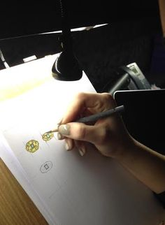 Amy working on some ring designs! #bespoke #jewellerydesign #handdrawnsketches