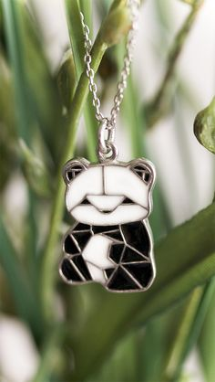 Shake up your accessorizing routine with this crafted origami panda necklace. Expressing your passion for this adorable creature couldn't be easier!