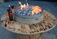Like the fire pit with a ledge idea.How To Build Wine Barrel Fire Pit. Wine Barrel Fire Pit, Wine Barrel Table, Wine Barrel Furniture, Wine Barrels, Barrel Projects, Diy Projects, Furniture Projects, Glass Fire Pit, Wine Craft