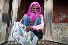 Man Reading newspaper at Holi Color Festival
