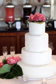 This is a buttercream cake with fondant lace appliques on the tall tier. This was somewhat of a copy that the bride had seen online. Inside ...