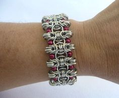 Byzantine chainmaille bracelet with hot pink glass pearls, chain mail bracelet, chainmail bracelet, chain maille bracelet by TheArmorersWife on Etsy https://www.etsy.com/listing/204749326/byzantine-chainmaille-bracelet-with-hot