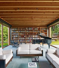 Large sliding glass doors suspend the living room within the landscape for family gatherings or larger events.   Photo by Bruce Damonte. ...