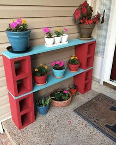 I love this for our front porch. The girls will love doing this project, especially putting the flowers in the pot. One thing I would change is the brick color, since our front door is red already it will be just to much red.