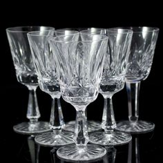"DESCRIPTION:Set of six Waterford crystal wine glasses. Adorned with diamond cut clusters as well as oval cuts in between each. Finished with a beveled stem and circular base. Marked:""Waterford"" on the bottom. CIRCA:20th Ct. ORIGIN:Ireland DIMENSIONS:H:6.75"" Diameter:3.5"""