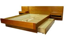 Fantastic mid century teak veneer platform bed. Made in Denmark. Featuring floating nightstands with drawer and a large storage drawer underneath the bed. No box spring needed. The mattress g...