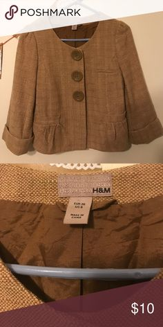H&M Blazer 3/4 length sleeves, big buttons that are actually snaps. Tweed, mustard color. Brown inside lining. Great condition! Faux front pockets. H&M Jackets & Coats Blazers