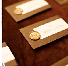 Cards pressed to match the invitations were placed in mini envelopes and sealed with gold wax.