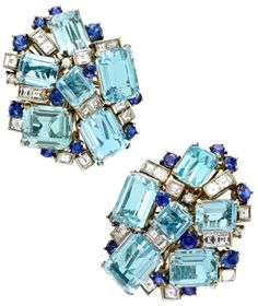 Vintage Aquamarine, Sapphire and, Diamond Cluster Earrings, circa 1960. A pair of aquamarine, sapphire and diamond cluster earrings, each designed as a large open asymmetric cluster with large rectangular cut aquamarines circular cut sapphires and square cut diamonds, mounted in platinum. Via 1stdibs.