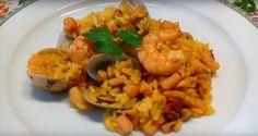 Arroz con calamares, almejas y langostinos. Un rico arroz de marisco elaborado con un caldo de pescado y verduras. Muy fácil de hacer y con mucho sabor que está riquísimo.