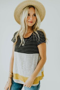 Say hello to your new favorite short sleeve top! The Earning Stripes Tee features unique panels with contrasting stripes, adding a trendy element to your wardrobe. With additional features such as a hi-lo hem, round neckline, + a comfortable material blend, this top is a no brainer!