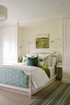 I love the fabric headboard and end of the bed as well as the green and blue color scheme.