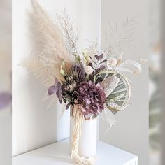 Everlasting Boho Blooms - A combination of dried and persevered flowers. Hot trend and flowers you can keep for years. Boho blooms channels in the look and feel of a natural bouquet to make it feel like fresh but with some dried textures.