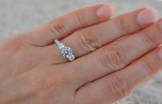 Sterling silver unique design man made diamond simulant cz engagement ring. High shine three stones engagement ring. Top quality ring. by Jadorelli on Etsy