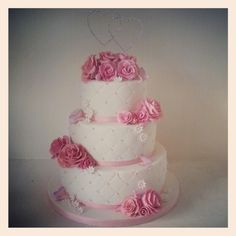 Romantic classic wedding cake with pink roses