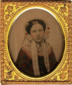 Tinted Ambrotype 1850s illustrating how charming a lovely face surrounded by a bonnet could be.
