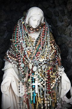 This statue of The Madonna was covered in rosaries, placed by random people passing by. (She was located outside a gas station.) via SheepInABottle Flickr