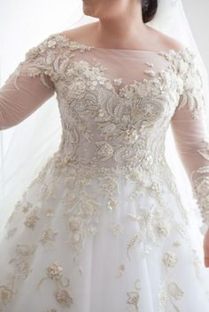 Long sleeve plus size wedding dresses for the modest bride with curves. An ornately embellished bridal gown with long sheer sleeves to cover the arms. Discover other long sleeve plus size wedding dresses at http://www.dariuscordell.com/featured_item/custom-wedding-dresses-custom-bridal-gowns/ (replicas of couture pieces and custom designs are an option)
