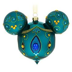 Mickey Mouse Icon Glass Ornament - Peacock | Disney Store You'll be proud as a peacock when hanging this dazzling Mickey Mouse icon glass droplet ornament with glittering golden filigree and faceted multicolor gems.
