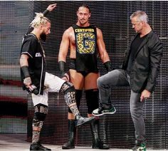 Shane McMahon and Enzo Amore saluting each other at Monday Night Raw with Big Cass watching here