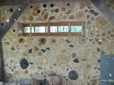 "Jason's Cordwood House: ""Jason and Alayne discovered this great foundation that was built with a wise eye towards passive solar design and insulative walls. They are now building a home incorporating other smart features such as cordwood walls and a living roof which will have rainwater pumped with a solar pump up to it, irrigating the roof and keeping the house cool."""