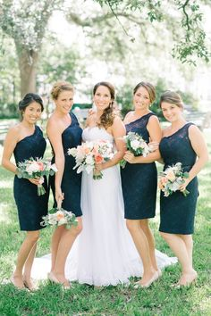 Beautiful one-shoulder lace bridesmaid dresses in navy. | Aaron & Jillian Photography