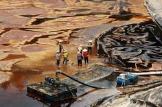 Workers drain a leaking sewage tank at a copper mine in Shanghang, China on July 13, 2010. One of China's biggest gold producers was ordered to pay $4.62 million by a local court for a toxic spill. The court also issued prison terms ranging between three years to 42 months to five staff who were found to be involved in the incident, which affected water supplies for 60,000 people. (Stringer/Reuters) #