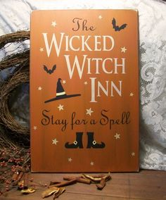 """""""The Wicked Witch Inn"""" Wood Primitive Sign Halloween Painted. $33, via Etsy."""