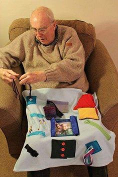 One of the best gifts you can give to someone that has Alzheimer's is a Busy Blanket (or Fidget Blanket) . No need to make it too large, lap size will do. Just make it colorful with lots of textures; add zippers and gadgets, etc. This will help with sensory stimulation and keep their hands busy while occupying their mind to reduce the potential of agitation