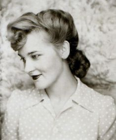 1940's. LOVE the hairstyle and the top.