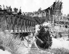 1913 view showing a partially completed Colorado Street Bridge with the Scoville Bridge in the foreground, it survived until a 1914 flood carried the trestle all the way down to the Los Angeles River San Gabriel Mountains, San Gabriel Valley, California History, Southern California, Vintage California, Colorado Street Bridge, Altadena California, San Luis Obispo County, San Fernando Valley