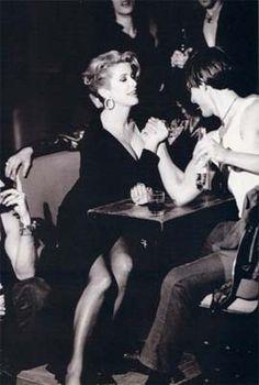 Catherine Deneuve arm wrestling. Because why not.